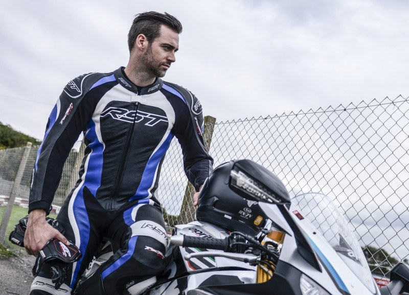 RST_blue_tractech_evo_1pc_leaning_on_bike_